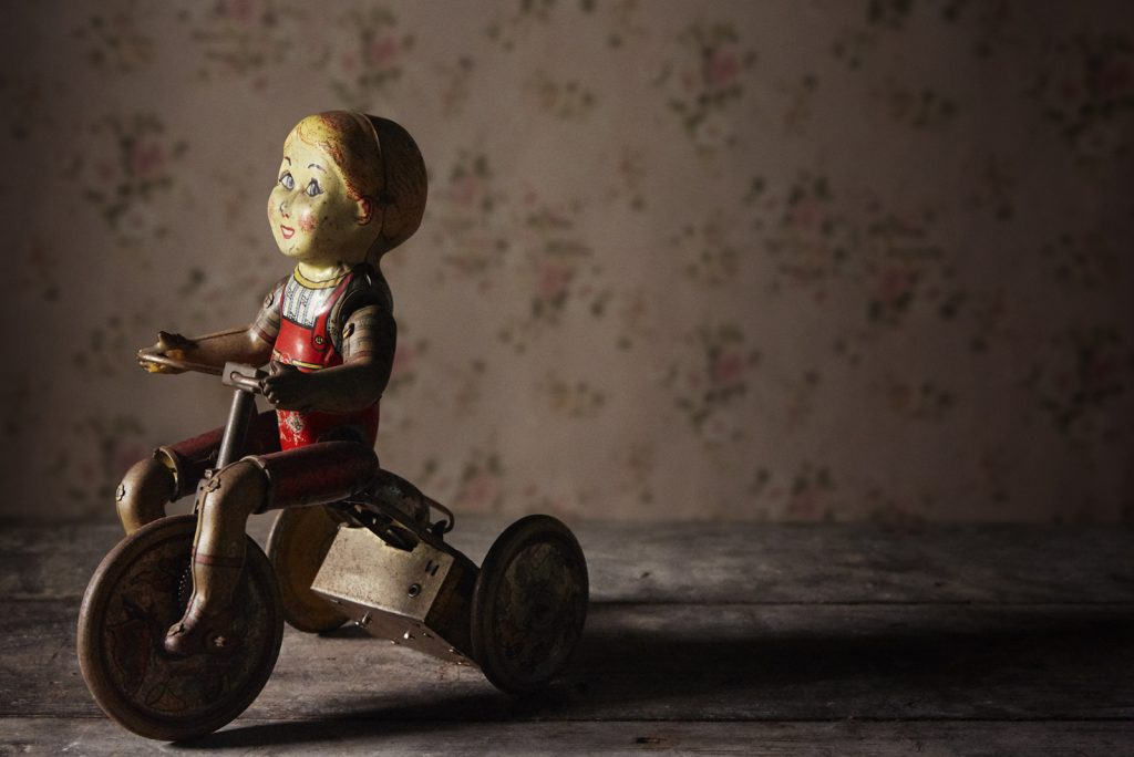 Photograph by Claudia Chan Shaw - Not speed I need, but time. Picture of old child's toy.